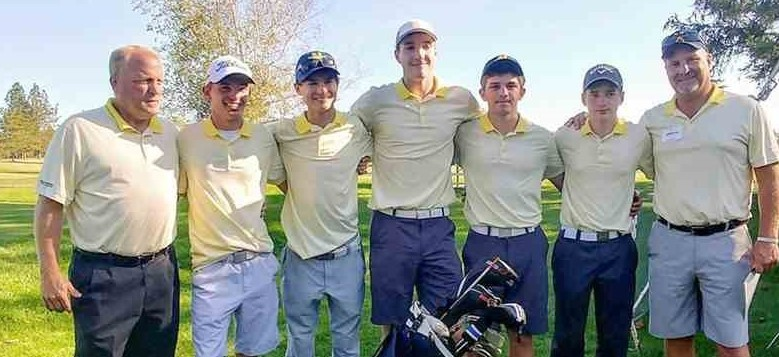 The Norwalk boys golf team after winning a Division I sectional championship on Tuesday at Mohawk golf course in Tiffin.