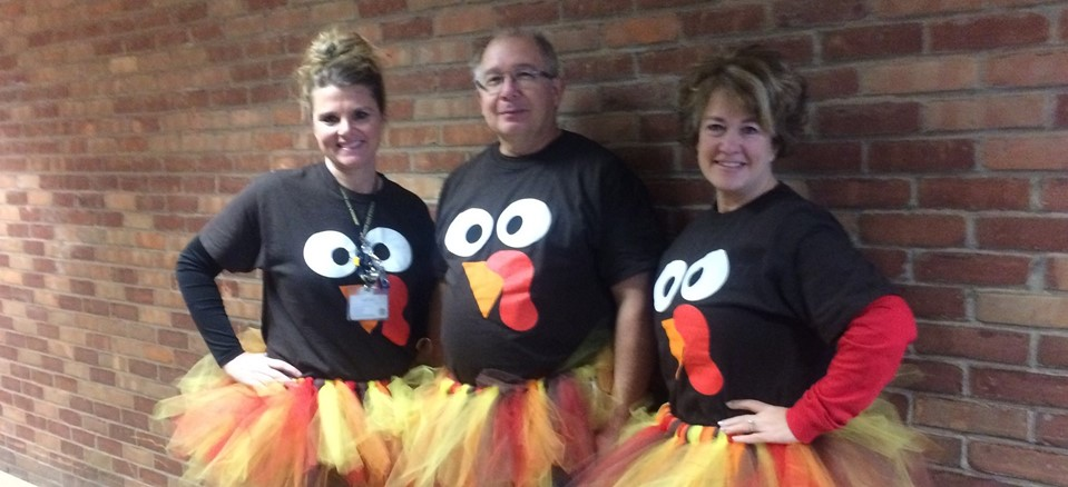 Mrs. Cook, Mr. Twary, and Mrs. Heitsche get festive for Thanksgiving