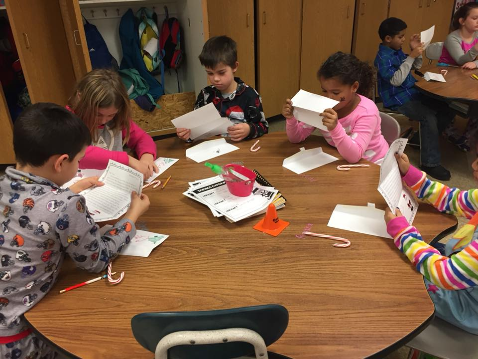 Students reading their letters from Santa