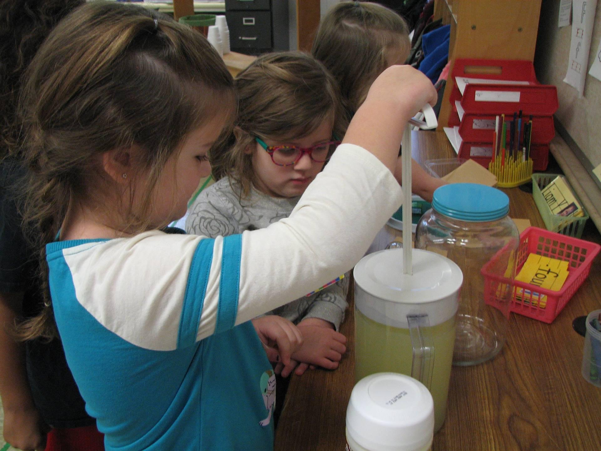 Preschoolers enjoy their lemonade stand