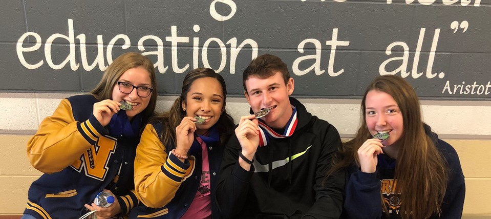 Alexis Gendron, Heaven Thompson, Austin Brown, and Kamryn Guerrier show off their medals from the Huron County AAA Teen Driving Challenge.
