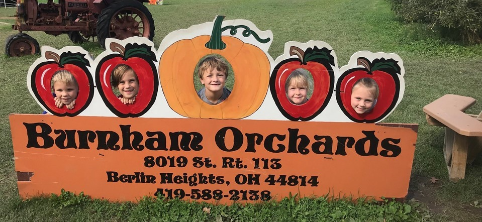 Grade K students enjoy a field trip to Burnham Orchards