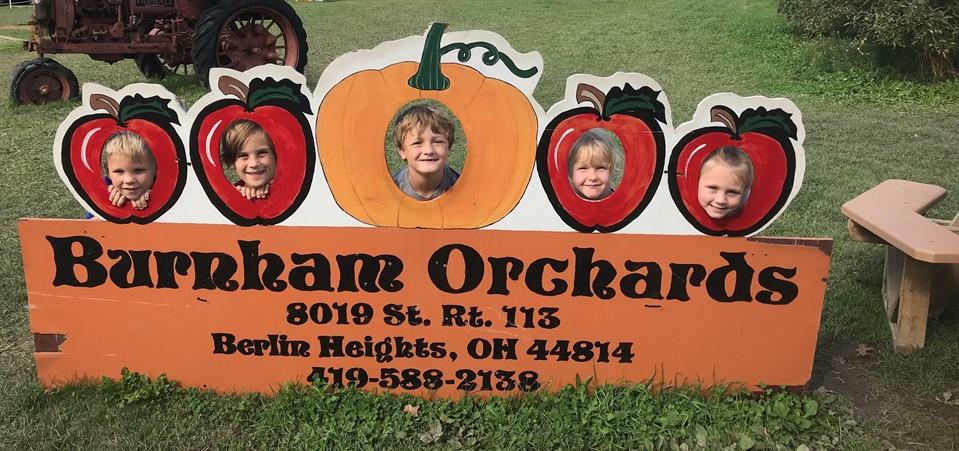 Grade K students enjoy a field trip to Burnham Orchards