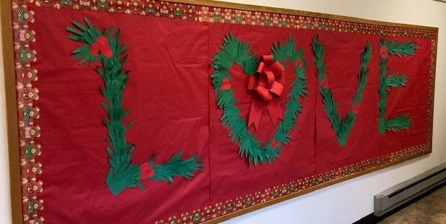 "Bulletin board made with hand cut out spelling out ""Christmas is LOVE"""