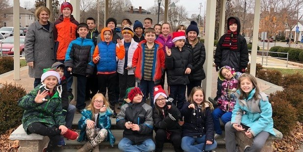 Mrs. Adkinson with her students at the gazebo in Downtown Norwalk