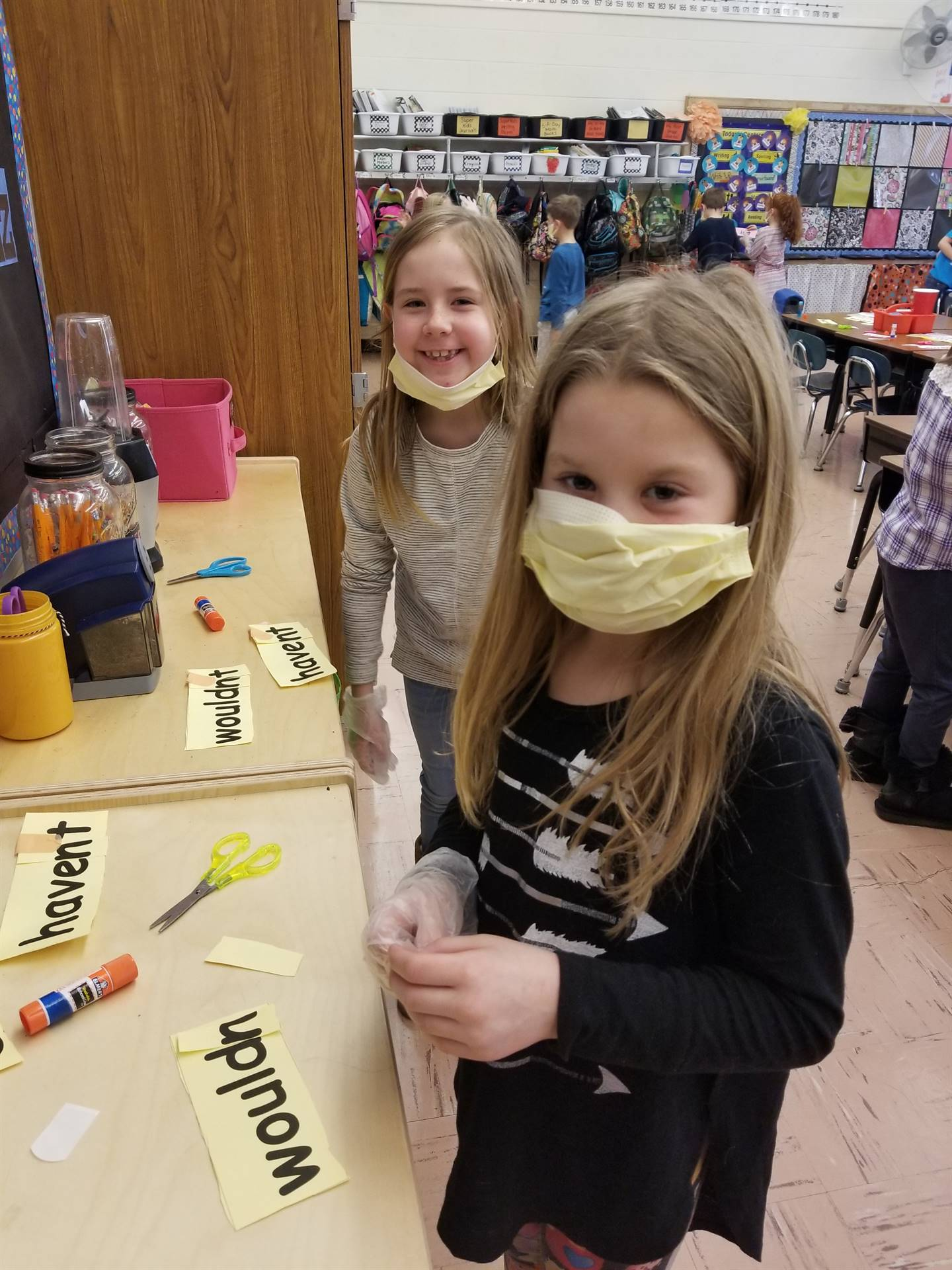"First graders perform ""surgery"" by cutting words and mending them into contractions!"