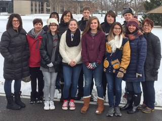 "Students lay wreaths at Veterans' headstones as part of ""Wreaths Across America"""
