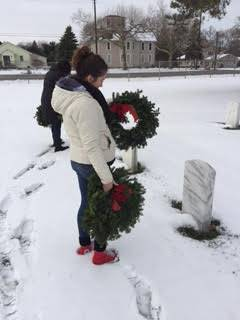 "Students lay wreaths at Veterans' headstones as part of ""Wreaths Across America"""