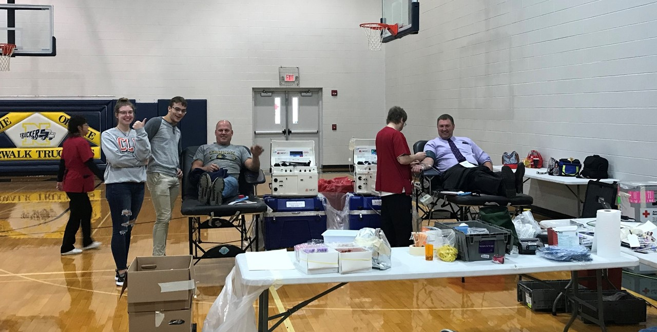 Firefighter Jeff Phillips and NHS Principal Mr. Cooley give blood at a recent Red Cross Blood Drive.