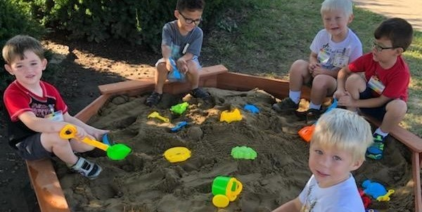 Preschool students enjoy their new sand box
