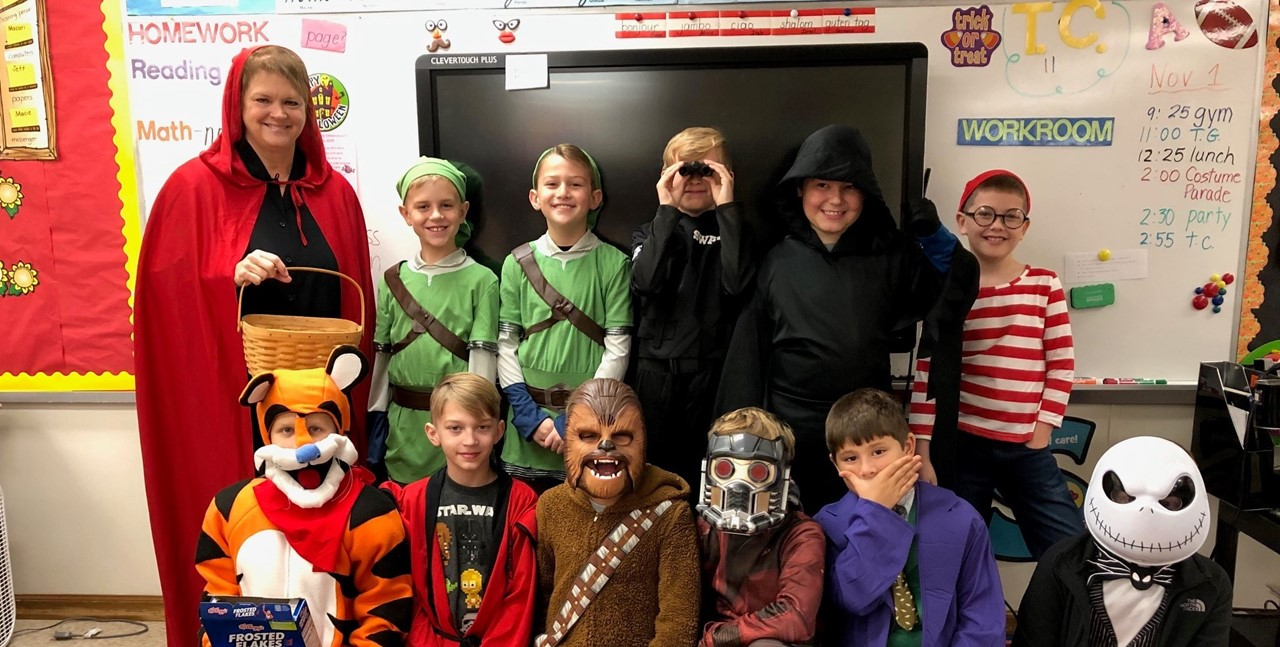 Mrs. Adkinson's class ready for their Halloween party