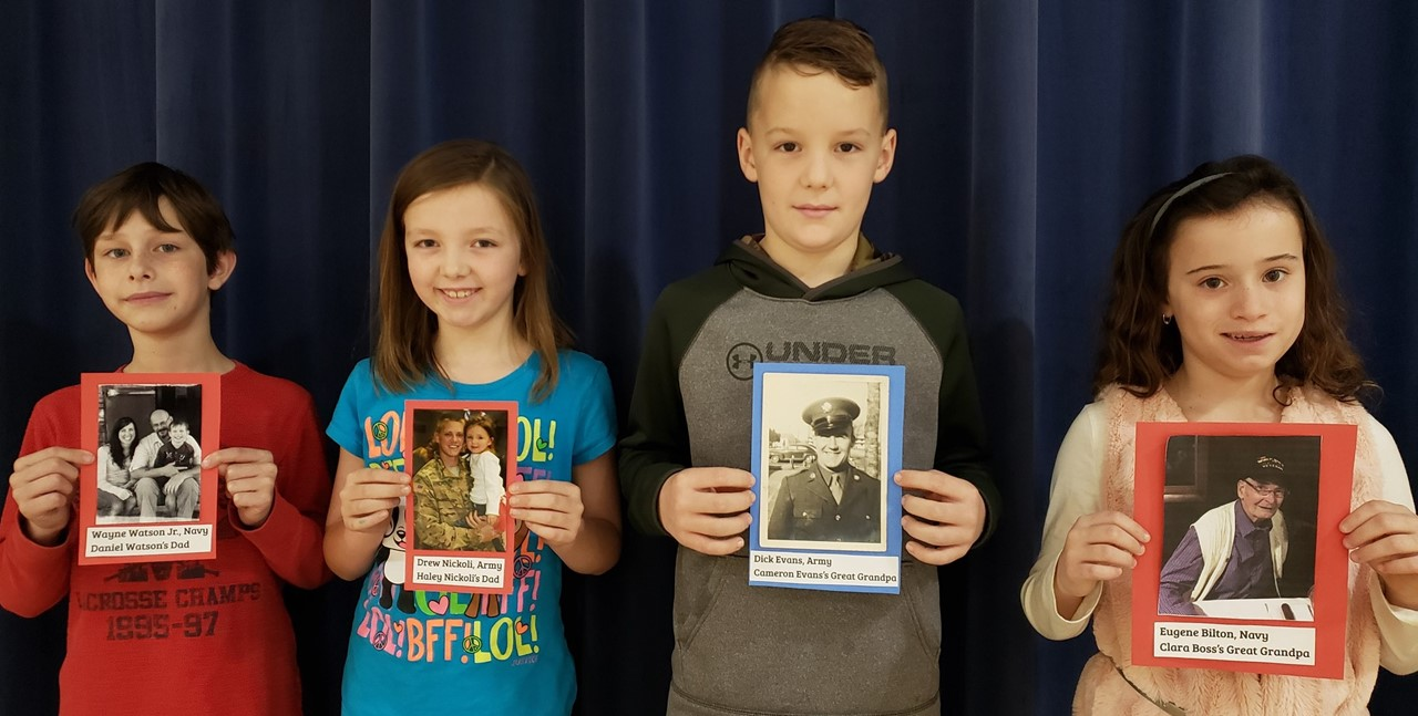 students brought in pictures of family members who are veterans