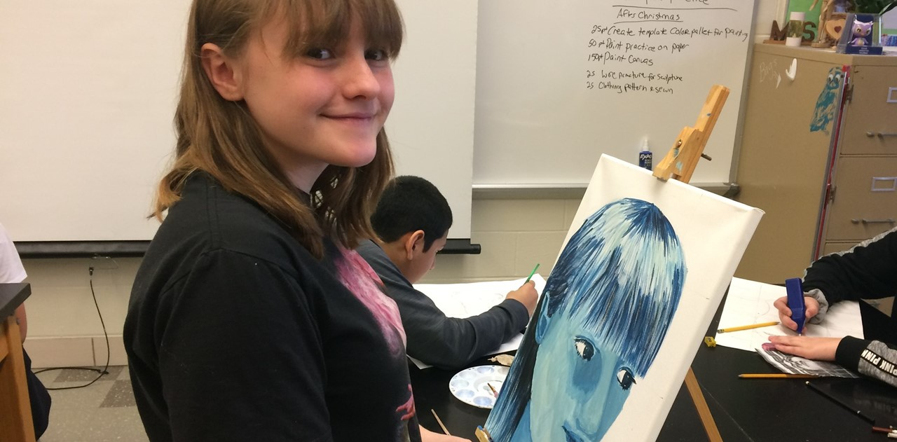 Advanced art students work on self potraits