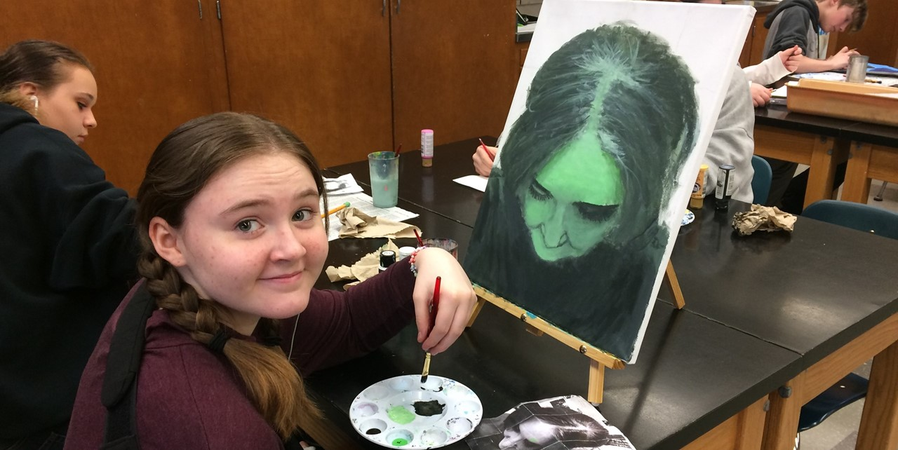 Advanced art students work on projects