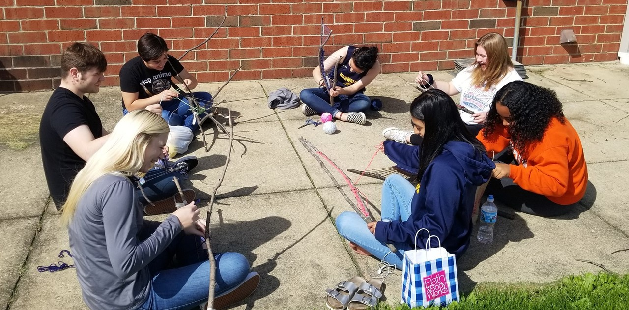 NHS Art Class outside working on a project