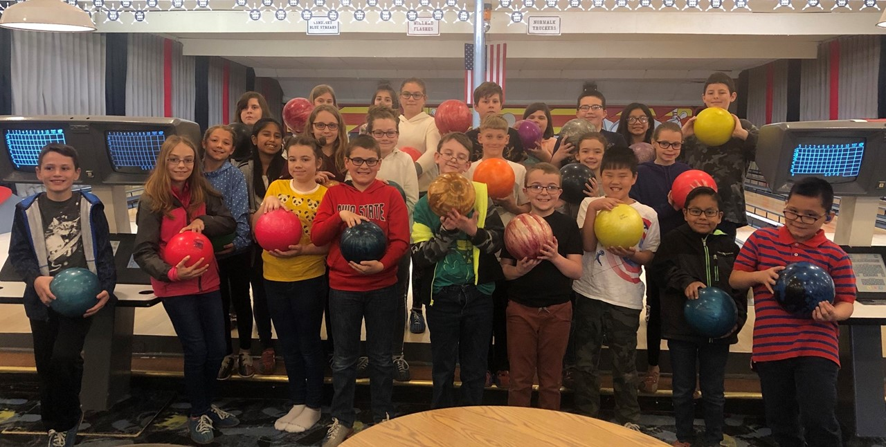 A group of 25 fourth graders from League Elementary had a great time bowling at Kenilee Lanes this week. The bowling party was a reward for all students who read at least 40 books in the fourth grade. Students had to read books at their reading level and pass a test on each book in order for the book to count towards their goal.