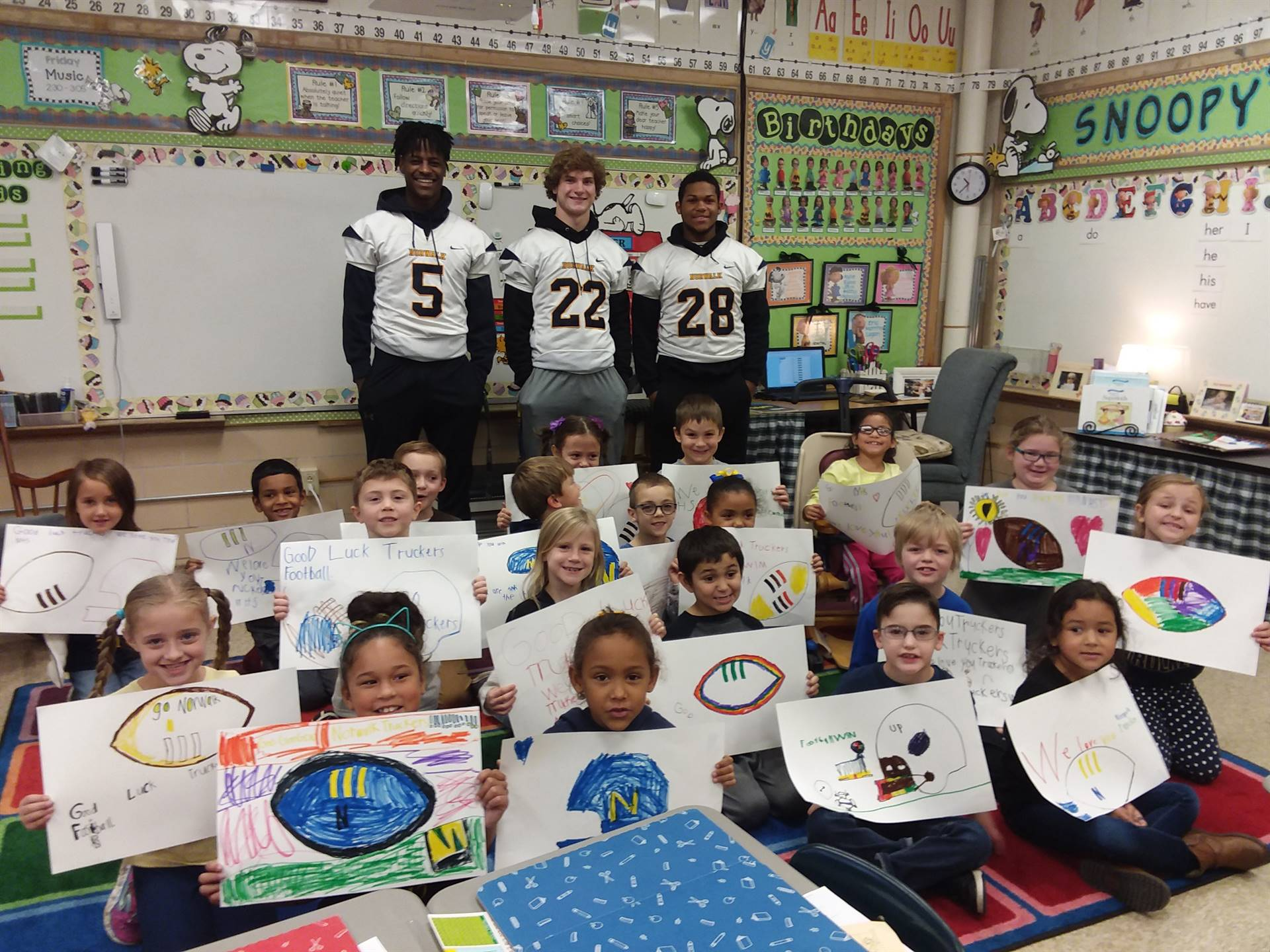 NHS football players visit Maplehurst Elementary
