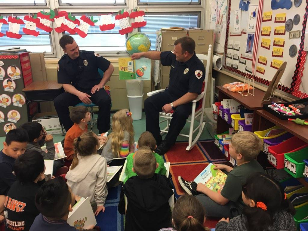 Fireman reading to students