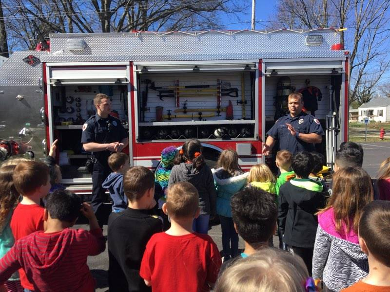 Fireman talking with students