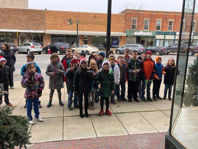 Caroling at local businesses